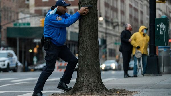 A police officer stands guard while a man is shooting outside the Cathedral Church of St. John the Divine in the Manhattan borough of New York City, New York, U.S., December 13, 2020   - Sputnik International