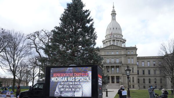 Motorist's participate during a drive-by rally to certify the presidential election results near the Capitol building in Lansing, Mich., Saturday, Nov. 14, 2020 - Sputnik International