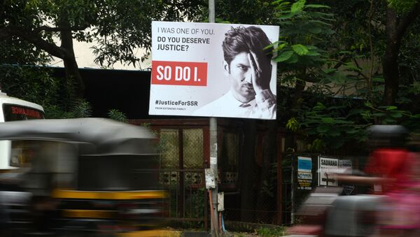 Vehicles drive past a hoarding put up to seek justice following the suicide of actor Sushant Singh Rajput, in Mumbai on September 28, 2020 - Sputnik International