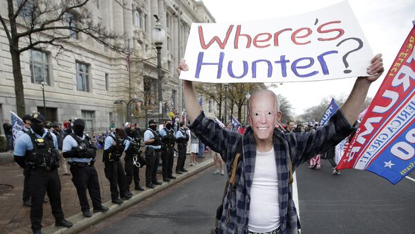 A supporter of President Donald Trump dressed as Joe Biden participates in a demonstration in Freedom Square in Washington, Saturday, December 12, 2020 - Sputnik International