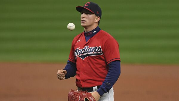 Cleveland Indians relief pitcher James Karinchak waits before being removed during the fourth inning of Game 2 of the team's American League wild-card baseball series against the New York Yankees, Wednesday, Sept. 30, 2020, in Cleveland.  - Sputnik International