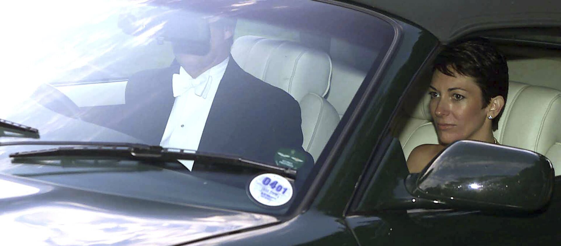n this Sept. 2, 2000 file photo, British socialite Ghislaine Maxwell, driven by Britain's Prince Andrew leaves the wedding of a former girlfriend of the prince, Aurelia Cecil, at the Parish Church of St Michael in Compton Chamberlayne near Salisbury, England. The FBI said Thursday July 2, 2020, Ghislaine Maxwell, who was accused by many women of helping procure underage sex partners for Jeffrey Epstein, has been arrested in New Hampshire.  - Sputnik International, 1920, 23.03.2021