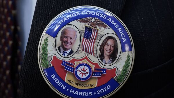 Electoral College elector Mark Miller wears a Joe Biden and Kamala Harris button after electors cast their votes for President of the United States at the state Capitol, Monday, Dec. 14, 2020 in Lansing, Mich. - Sputnik International
