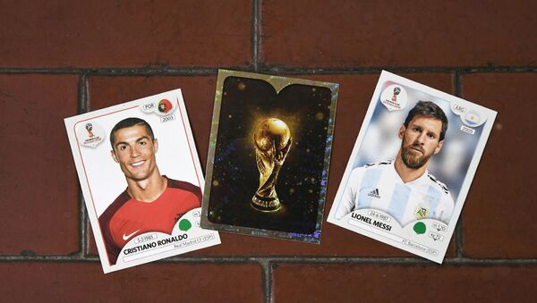 This photo taken on April 20, 2018 shows collectible cards featuring (L-R) Portugal's forward Cristiano Ronaldo, the Fifa World Cup Trophy and Argentina's forward Lionel Messi as part of a series featuring players for the 2018 Russia football World Cup at the Panini Group factory in Modena, northern Italy. - Sputnik International