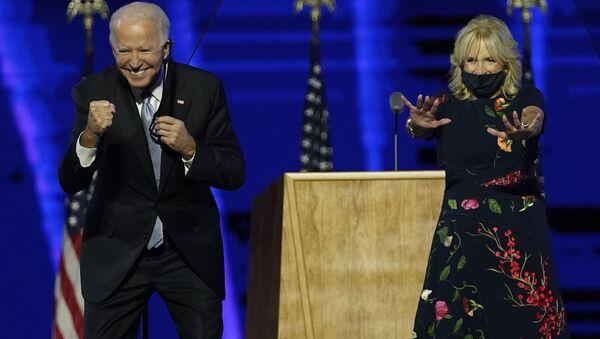 President-elect Joe Biden and wife Jill Biden gesture to supporters Saturday, Nov. 7, 2020, in Wilmington, Del.  - Sputnik International
