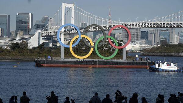 The Olympic Symbol is reinstalled after it was taken down for maintenance ahead of the postponed Tokyo 2020 Olympics in the Odaiba section Tuesday, Dec. 1, 2020, in Tokyo. - Sputnik International