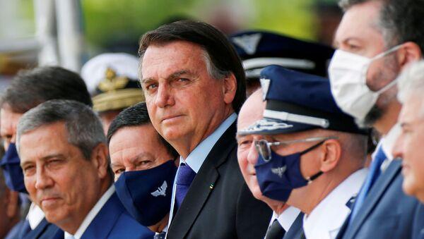 Brazil's President Jair Bolsonaro (C) looks on during a ceremony of Aviator's Day at Brasilia Air Base in Brasilia, Brazil October 23, 2020.  - Sputnik International