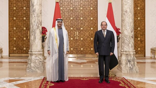 Egypt's president, Abdel Fattah Al-Sisi, and Abu Dhabi's Crown Prince and Deputy Supreme Commander of the United Arab Emirates Armed Forces Mohammed bin Zayed Al Nahyan, pose for a photo during the prince's visit to Cairo on Wednesday 16 December 2020. - Sputnik International