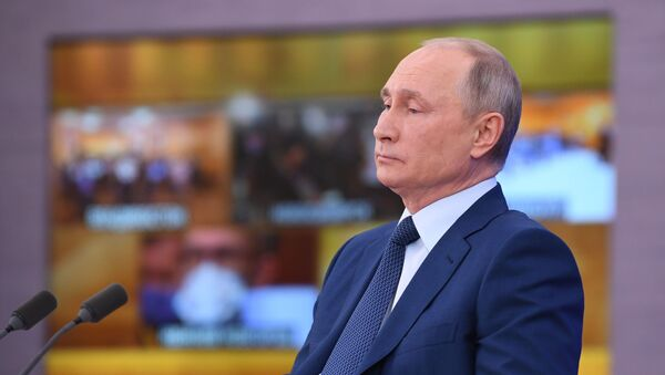 Russian President Vladimir Putin delivers his annual end-of-year news conference, held online in a video conference mode, at the Novo-Ogaryovo state residence outside Moscow, Russia - Sputnik International