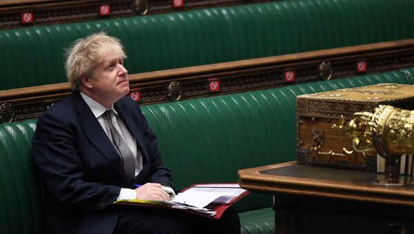 A handout photograph released by the UK Parliament shows Britain's Prime Minister Boris Johnson attending Prime Minister's Questions (PMQs), in a socially distanced and hybrid session of the House of Commons, in central London on 16 December 2020 - Sputnik International