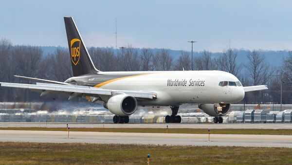 A UPS Boeing 757 carrying two air shipping containers of the Pfizer COVID-19 vaccine lands at Louisville Muhammad Ali International Airport in Louisville, Kentucky, December 13, 2020. - Sputnik International