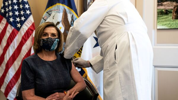 U.S. Speaker of the House Nancy Pelosi (D-CA) receives the Pfizer-BioNTech COVID-19 vaccine by Dr. Brian Monahan, attending physician of the United States Congress, at the Capitol in Washington, U.S., December 18, 2020. Anna Moneymaker/Pool via REUTERS     TPX IMAGES OF THE DAY - Sputnik International
