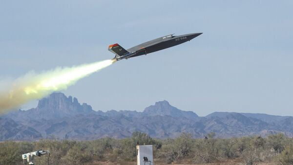 An XQ-58A Valkyrie low-cost unmanned aerial vehicle launches at the U.S. Army Yuma Proving Ground, Ariz., Dec. 9, 2020 - Sputnik International