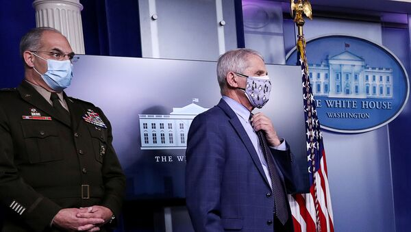 U.S. Army Gen. Gustave Perna, who co-leads the Trump administration effort dubbed Operation Warp Speed to find a vaccine for the coronavirus disease (COVID-19), and Dr. Anthony Fauci, director of the National Institute of Allergy and Infectious Diseases, listen during a briefing by the White House coronavirus task force in the Brady press briefing room at the White House in Washington, U.S., November 19, 2020.  - Sputnik International
