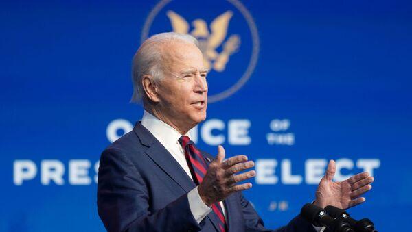 U.S. President-elect Joe Biden introduces key members of their administration in Wilmington, Delaware, U.S., December 19, 2020. REUTERS/Kevin Lamarque - Sputnik International