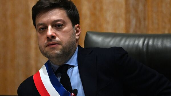 Socialist Party's new mayor of Marseille Benoit Payan wearing the mayor's scarf looks on during the handover of power ceremony in Marseille on December 21, 2020.  - Sputnik International