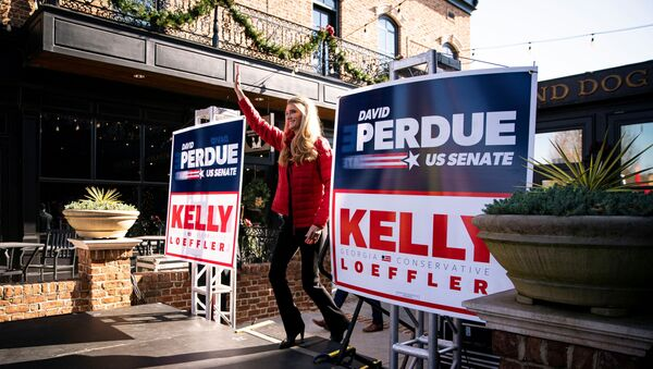 Senator Kelly Loeffler (R-GA) arrives on the stage during a campaign event with Senator David Perdue (R-GA) and White House senior advisor Ivanka Trump (not pictured) at the Olde Blind Dog Irish Pub, in Milton, Georgia, U.S., December 21, 2020 - Sputnik International