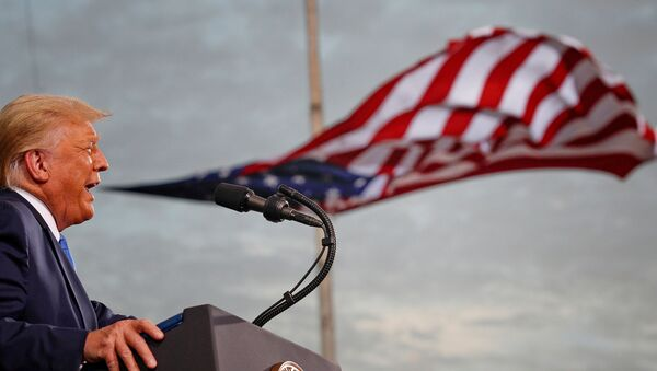 President Donald Trump speaks, with a flag behind him, during a campaign rally at Cecil Airport in Jacksonville, Florida, US, 24 September 2020. - Sputnik International