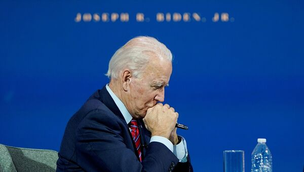 U.S. President-elect Joe Biden listens as he holds a videoconference meeting with members of the U.S Conference of Mayors at his transition headquarters in Wilmington, Delaware, U.S., November 23, 2020.  - Sputnik International