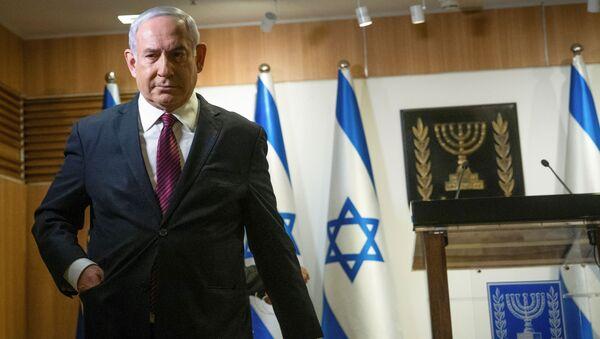 Israeli Prime Minister Benjamin Netanyahu walks after he delivered a statement at the Knesset (Israel's parliament) in Jerusalem, December 22, 2020 - Sputnik International