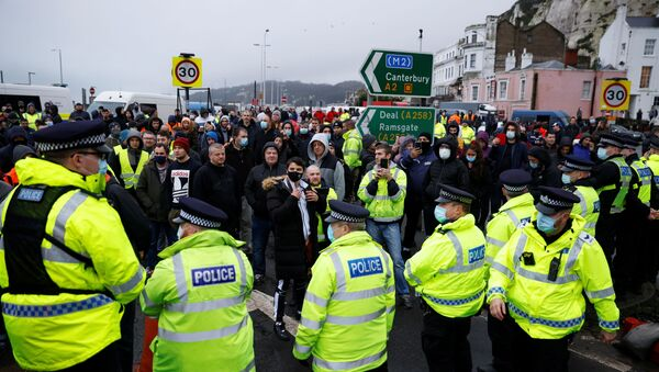 Drivers stand in front of police officers as they block the exit at the Port of Dover, as EU countries impose a travel ban from the UK following the coronavirus disease (COVID-19) outbreak, in Dover, Britain, December 23, 2020 - Sputnik International
