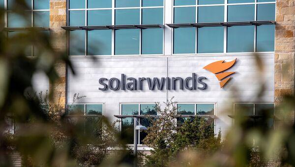 The SolarWinds logo is seen outside its headquarters in Austin, Texas, U.S., December 18, 2020. - Sputnik International