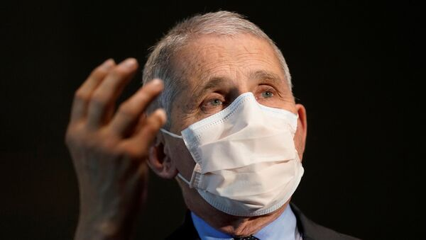 Dr. Anthony Fauci, director of the National Institute of Allergy and Infectious Diseases, speaks with Health and Human Services Secretary Alex Azar before receiving his first dose of the new Moderna COVID-19 vaccine at the National Institutes of Health, in Bethesda, US, 22 December 2020 - Sputnik International