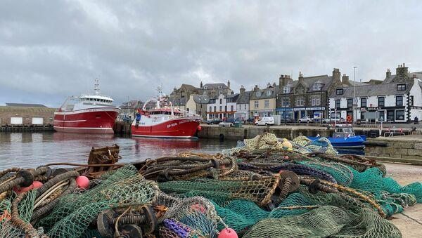 View of fishing boats and a net in the coastal town of Macduff, Aberdeenshire, Scotland, Britain October 18, 2020 - Sputnik International