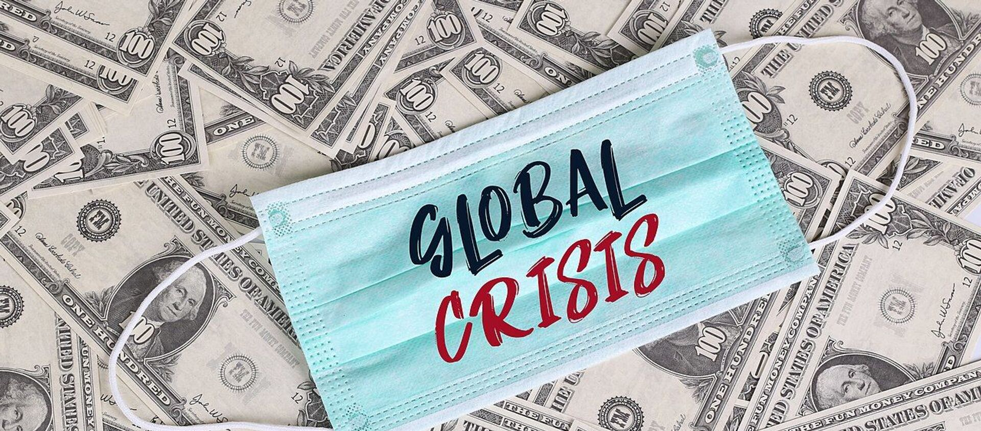 US Dollars and a face mask - Sputnik International, 1920, 24.12.2020