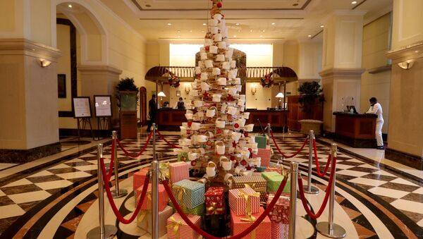 A Christmas tree is decorated with face masks inside a hotel lobby to create awareness about wearing a mask during the coronavirus disease (COVID-19) outbreak, ahead of Christmas celebrations, in Mumbai - Sputnik International