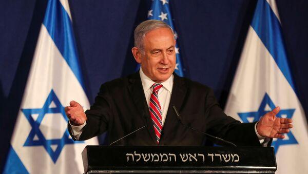 Israeli Prime Minister Benjamin Netanyahu speaks during a news conference with White House senior adviser Jared Kushner (not pictured), in Jerusalem December 21, 2020. - Sputnik International