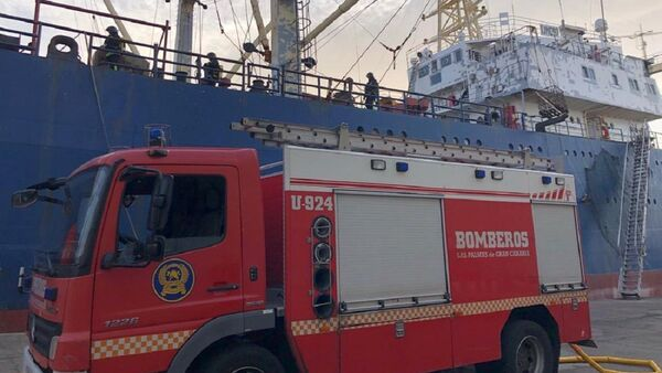 A photo of the Canarian fire engine near the Russian fishing vessel Sveaborg after the fire occured on it, December 25, 2020 - Sputnik International