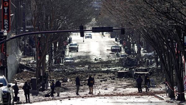 Investigators work near the site of an explosion on 2nd Avenue that occurred the day before in Nashville, Tennessee, U.S. December 26, 2020. - Sputnik International