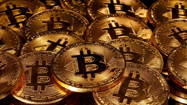 Representations of virtual currency Bitcoin are seen in this illustration taken taken 13 March 2020. - Sputnik International