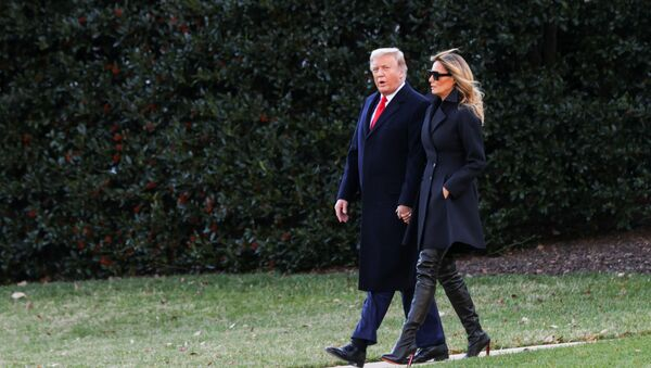 U.S. President Donald Trump, accompanied by first lady Melania Trump, departs from the White House for holiday travel to his home in Florida, in Washington, U.S., December 23, 2020.  - Sputnik International