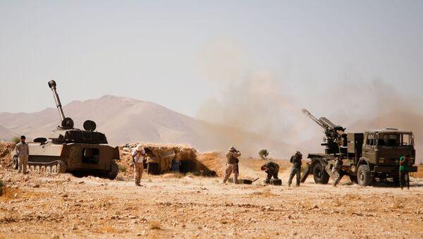 Hezbollah fighters stand near military tanks in Western Qalamoun, Syria August 23, 2017.  - Sputnik International