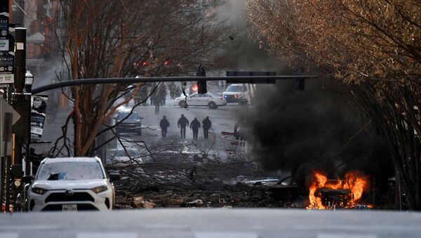 A vehicle burns near the site of an explosion in the area of Second and Commerce in Nashville, Tennessee, U.S. December 25, 2020. - Sputnik International