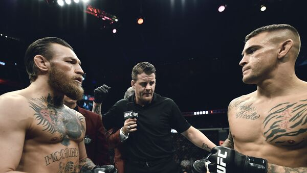 A photo of the McGregor-Poitier UFC bout in 2014 posted on Twitter December 27, 2020 - Sputnik International