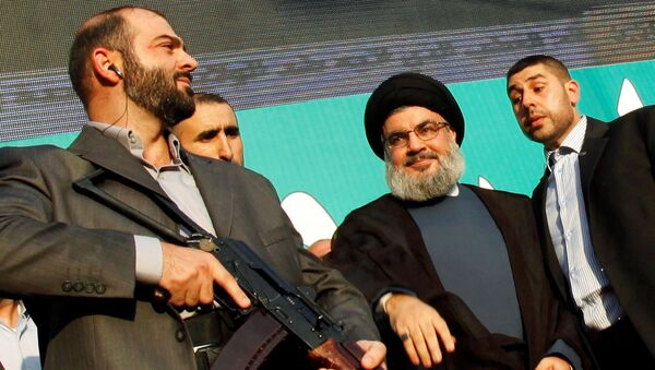 Lebanon's Hezbollah leader Sayyed Hassan Nasrallah (2nd R), escorted by his bodyguards, greets his supporters at an anti-U.S. protest in Beirut's southern suburbs, Lebanon September 17, 2012. - Sputnik International
