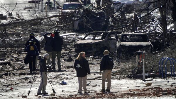 Investigators work near the blast site on 2nd Avenue in Nashville, Tennessee on 26 December after an RV exploded the day before, injuring four - Sputnik International