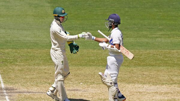Tim Paine of Australia congratulates India's Ajinkya Rahane after India won the match during day four of the second test match between Australia and India at The MCG, Melbourne, Australia, December 29, 2020. - Sputnik International