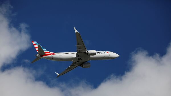 American Airlines flight 718, the first U.S. Boeing 737 MAX commercial flight since regulators lifted a 20-month grounding in November, takes off from Miami, Florida, U.S. December 29, 2020. - Sputnik International