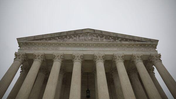 The United States Supreme Court during a rain storm on Capitol Hill in Washington, U.S., December 14, 2020 - Sputnik International
