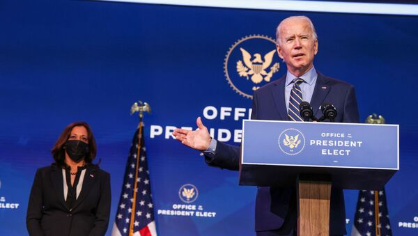 U.S. President-elect Joe Biden delivers a speech alongside U.S. Vice President-elect Kamala Harris after a conference video call focused on foreign policy at his transition headquarters in Wilmington, Delaware, U.S., December 28, 2020 - Sputnik International