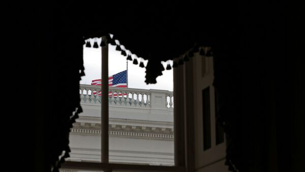 An American flag waves outside a window at the U.S. Capitol shortly before the Senate adjourns for the year, on Capitol Hill in Washington, U.S., December 31, 2020 - Sputnik International