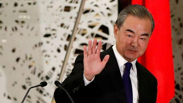 China's State Councillor and Foreign Minister Wang Yi waves as he leaves a news conference in Tokyo, Japan, November 24, 2020. REUTERS/Issei Kato/Pool/File Photo - Sputnik International