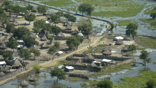 Thatched huts surrounded by floodwaters are seen from the air in Old Fangak county, Jonglei state, South Sudan Friday, Nov. 27, 2020. Some 1 million people in the country have been displaced or isolated for months by the worst flooding in memory, with the intense rainy season a sign of climate change.  - Sputnik International