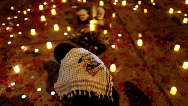 A person attends the first anniversary of the killing of senior Iranian military commander General Qassem Soleimani and Iraqi militia commander Abu Mahdi al-Muhandis in a U.S. attack, in Baghdad, Iraq, January 2, 2021 - Sputnik International