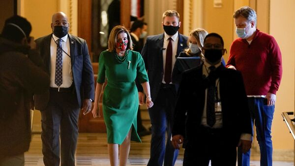 Speaker of the House Nancy Pelosi (D-CA) walks back to her office after opening the House floor following an agreement of a coronavirus disease (COVID-19) aid package the night before on Capitol Hill, Washington, D.C., U.S., December 21, 2020.  - Sputnik International