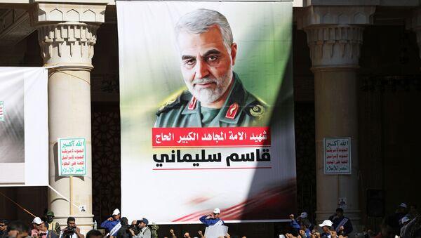People attend a vigil marking the one year anniversary of the killing of Iranian military commander General Qassem Soleimani and Iraqi militia commander Abu Mahdi al-Muhandis in a U.S. drone attack, in Sanaa, Yemen January 2, 2021. - Sputnik International